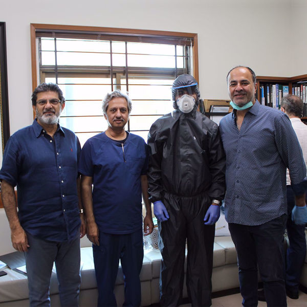 Picture of Deepak Perwani at the Patient Aid Foundation, Donating the reusable, water and air proof PPE suits to healthcare staff.